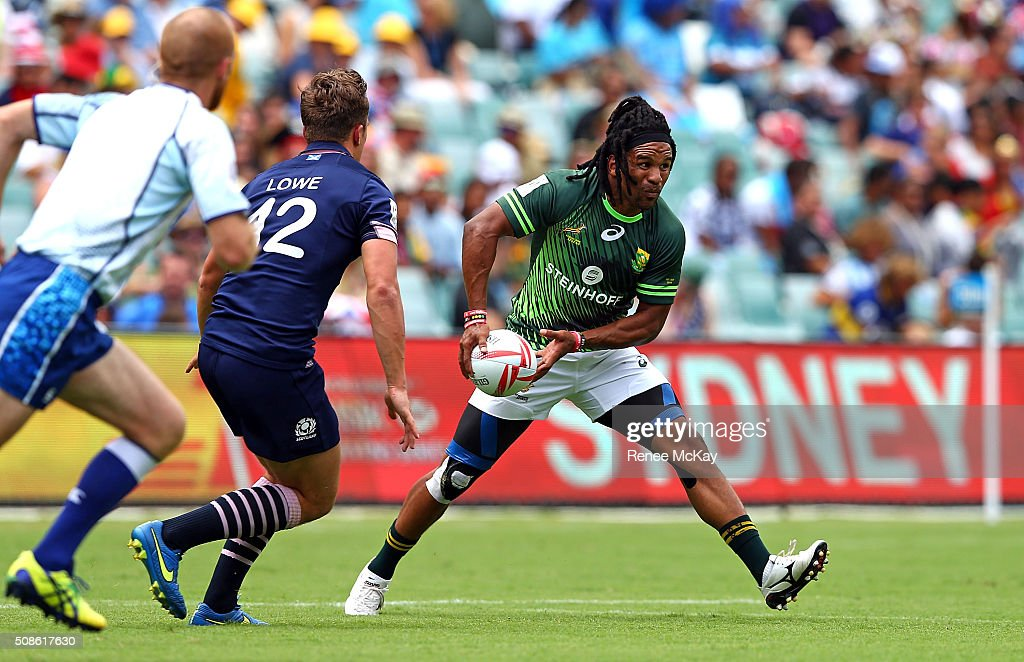 Rosko Specman of South Africa gets away from Gavin Lowe of Scotland during the day 1 match between South Africa and Scotland at the HSBC Sydney Sevens at Allianz Stadium on February 06, 2016 in Sydney, Australia.