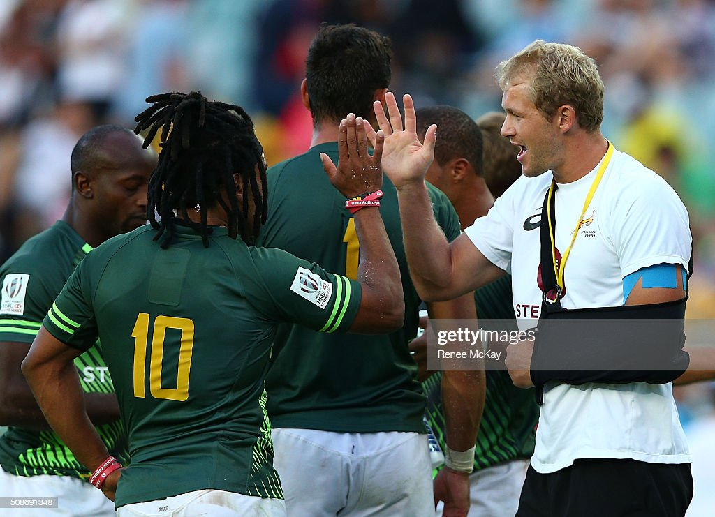 Rosko Specman of South Africa high fives injured team mate <a gi-track='captionPersonalityLinkClicked' href=/galleries/search?phrase=Kyle+Brown+-+Rugby+Player&family=editorial&specificpeople=5870383 ng-click='$event.stopPropagation()'>Kyle Brown</a> at the day 1 match between South Africa and Kenya at the HSBC Sydney Sevens at Allianz Stadium on February 06, 2016 in Sydney, Australia.