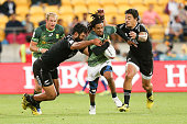 Rosko Specman of South Africa is tackled by Akira Ioane and Ben Lam of New Zealand during the 2016 Wellington Sevens cup final match between New...
