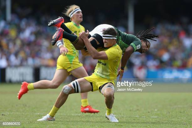 Rosko Specman of South Africa is tackled by Mick Adams of Australia during the Cup Semi Final match between Australia and South Africa in the 2017...