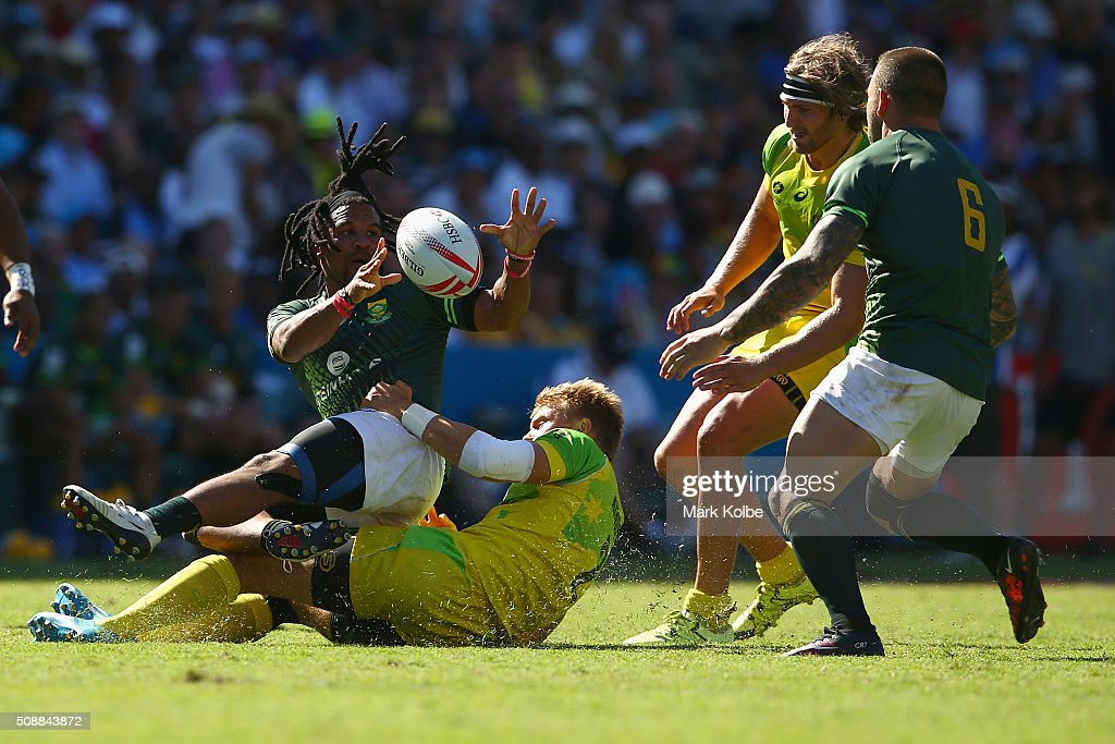Rosko Specman of South Africa passes as he is tackled during the 2016 Sydney Sevens cup semi final match between Australia and South Africa at Allianz Stadium on February 7, 2016 in Sydney, Australia.