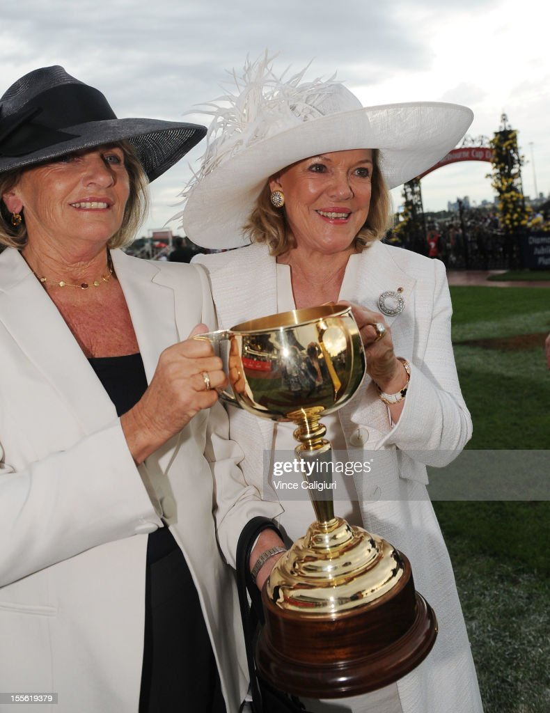Roslyn Packer, wife of the late Kerry Packer (R) holds the trophy with Suzy Williams (L), wife of Lloyd Williams after the Emirates Melbourne Cup during Melbourne Cup Day at Flemington Racecourse on November 6, 2012 in Melbourne, Australia.
