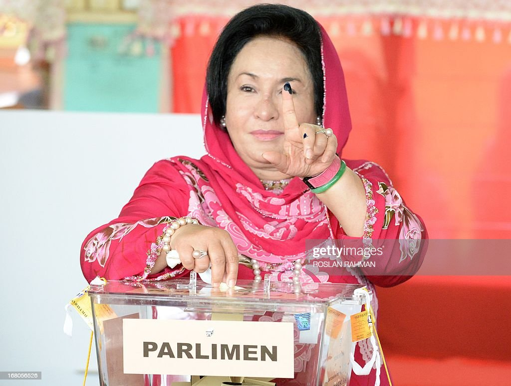 Rosmah Mansor wife of Malaysian Prime MInister Najib Razak, shows her inked finger while casting her vote at a polling station in Pekan on May 5, 2013. Malaysians voted in their first election in history with a change of government at stake, as a decades-old regime battles to hold off a rising opposition pledging sweeping reform.
