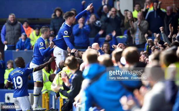 Ross Barkley and Everton team mates celebrate his goal with the crowd during the Premier League match between Everton and Burnley at Goodison Park on...