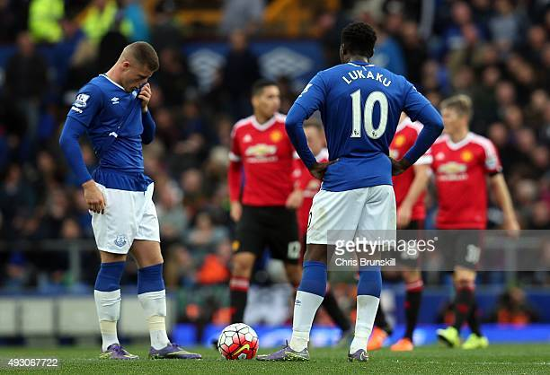 Ross Barkley and Romelu Lukaku of Everton look dejected as they wait to kickoff following Manchester United's third goal during the Barclays Premier...