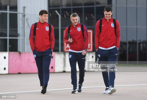Ross Barkley Jamie Vardy and Michael Keane of England walk to the plane as they leave for the International Friendly match against Germany at...