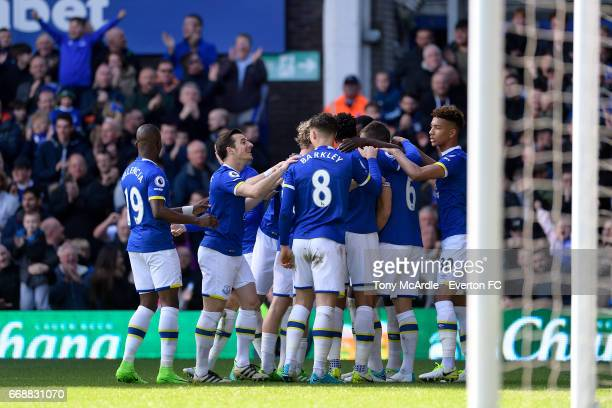 Ross Barkley Leighton Baines and team mates celebrate the goal of Phil Jagielka during the Premier League match between Everton and Burnley at...