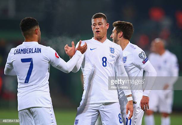 Ross Barkley of England celebrates with Alex OxladeChamberlain as he scores their first goal during the UEFA EURO 2016 qualifying Group E match...