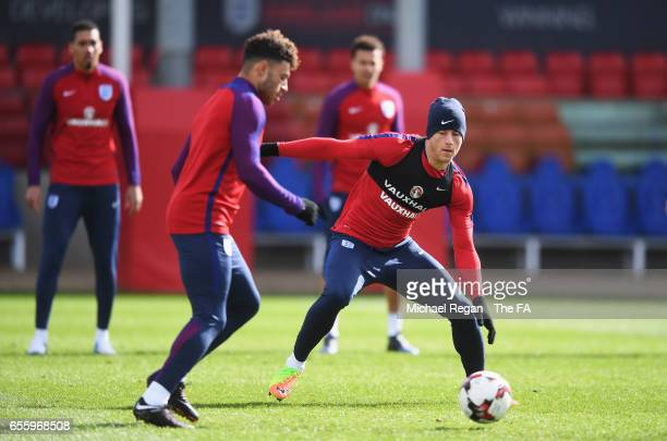 Ross Barkley of England closes down Alex OxladeChamberlain of England during an England training session at St Georges Park on March 21 2017 in...