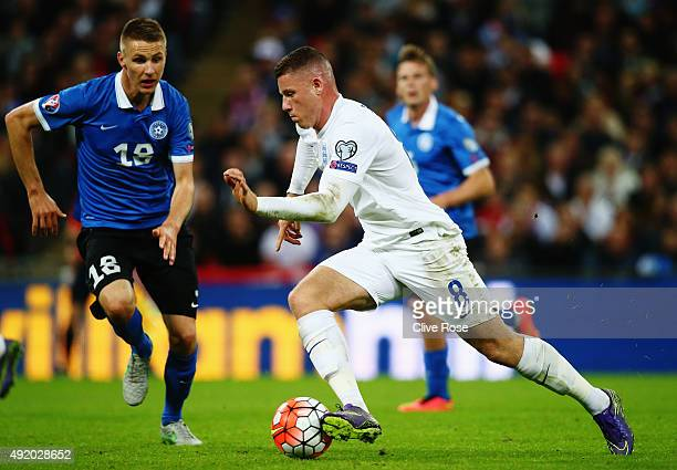 Ross Barkley of England takes on Karol Mets of Estonia during the UEFA EURO 2016 Group E qualifying match between England and Estonia at Wembley on...
