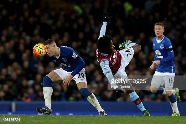 Ross Barkley of Everton and Carlos Sanchez of Aston Villa compete for the ball during the Barclays Premier League match between Everton and Aston...