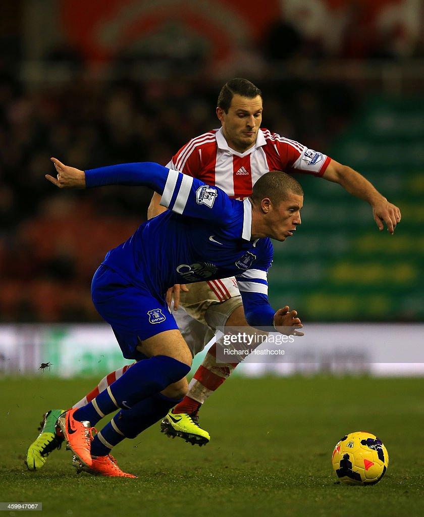 <a gi-track='captionPersonalityLinkClicked' href=/galleries/search?phrase=Ross+Barkley&family=editorial&specificpeople=5806369 ng-click='$event.stopPropagation()'>Ross Barkley</a> of Everton and Erik Pieters of Stoke City battle for the ball during the Barclays Premier League match between Stoke City and Everton at Britannia Stadium on January 1, 2014 in Stoke on Trent, England.
