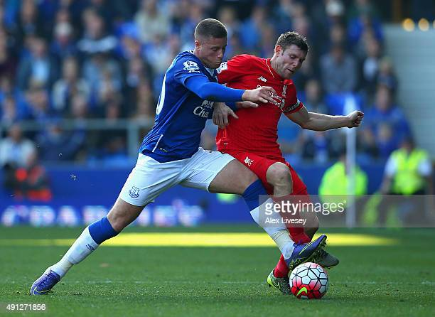 Ross Barkley of Everton and James Milner of Liverpool battle for the ball during the Barclays Premier League match between Everton and Liverpool at...