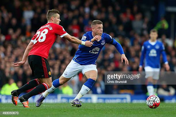 Ross Barkley of Everton and Morgan Schneiderlin of Manchester United compete for the ball during the Barclays Premier League match between Everton...