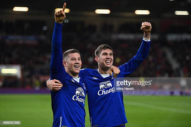 Ross Barkley of Everton celebrates scoring his team's third goal with his team mate John Stones during the Barclays Premier League match between AFC...