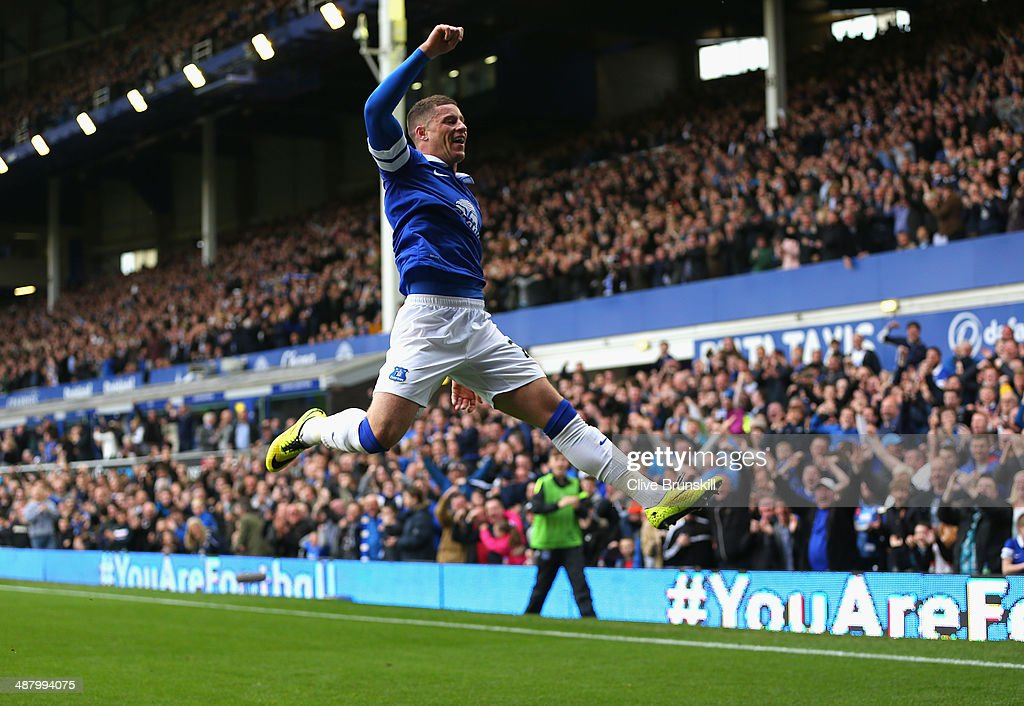 Ross Barkley of Everton celebrates scoring the opening goal during the Barclays Premier League match between Everton and Manchester City at Goodison...