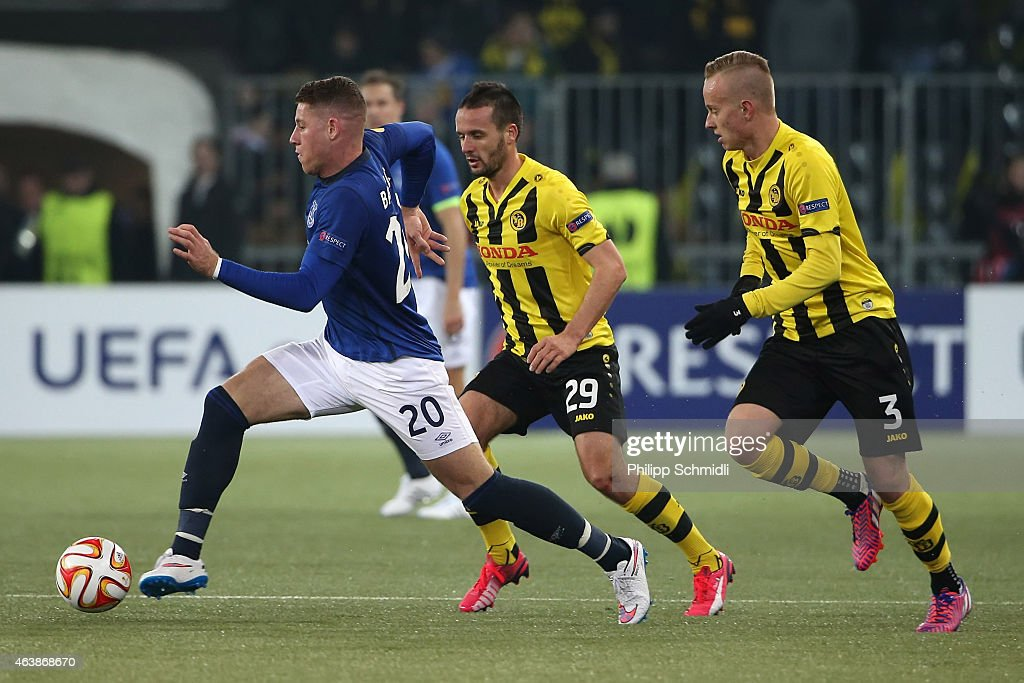 Ross Barkley (L) of Everton FC fights for the ball with Raphael Nuzzolo (C) and Florent Hadergjonaj of BSC Young Boys during the UEFA Europa League Round of 32 match between BSC Young Boys and Everton FC at Stade de Suisse, Wankdorf on February 19, 2015 in Bern, Switzerland.