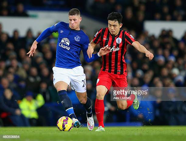 Ross Barkley of Everton holsa off Yoon SukYoung of QPR during the Barclays Premier League match between Everton and Queens Park Rangers at Goodison...