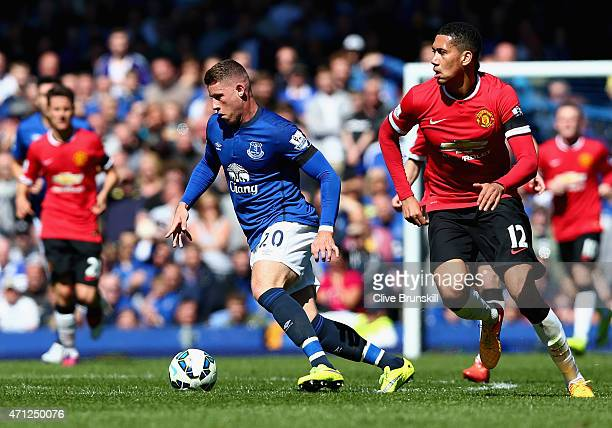 Ross Barkley of Everton in action with Chris Smalling of Manchester United during the Barclays Premier League match between Everton and Manchester...