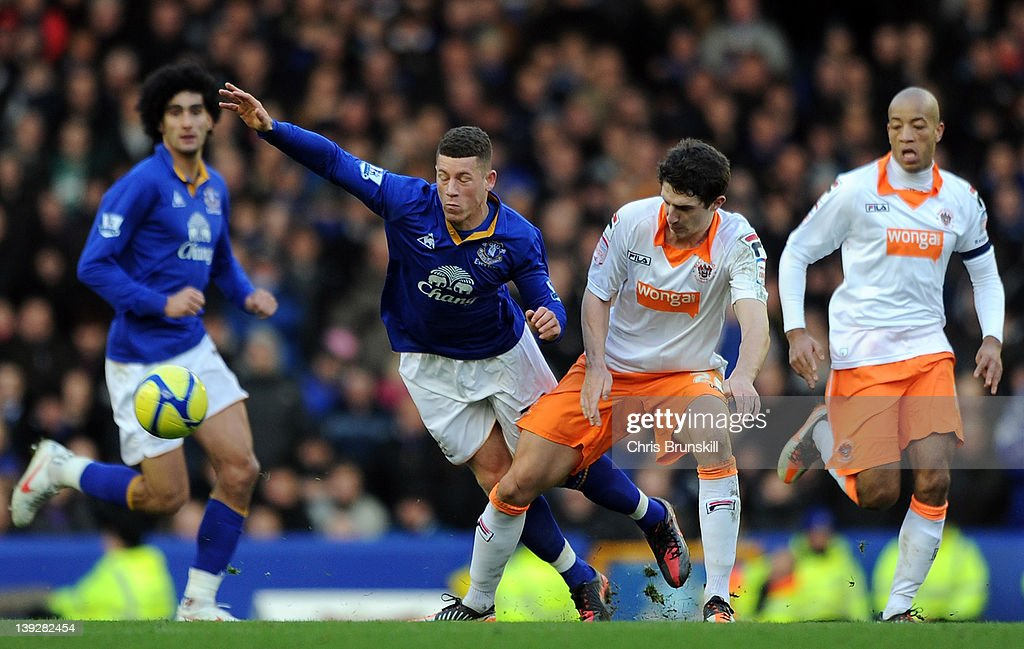Ross Barkley of Everton is challenged by Craig Cathcart of Blackpool during the FA Cup Fifth Round match between Everton and Blackpool at Goodison Park on February 18, 2012 in Liverpool, England.
