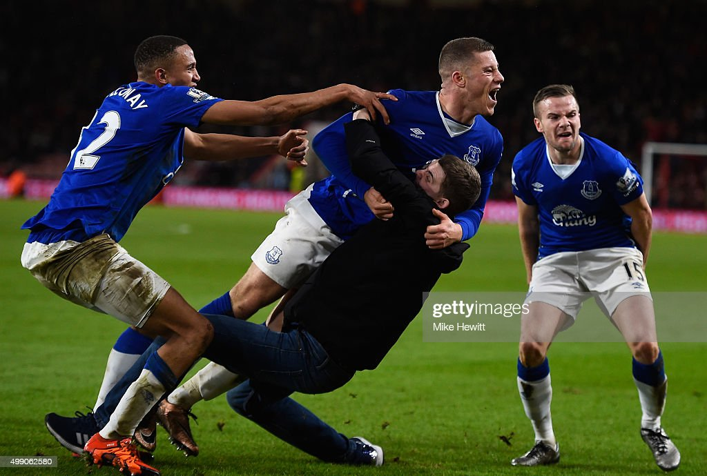 Ross Barkley (C) of Everton is congratulated by a pitch invading Everton fan during the Barclays Premier League match between A.F.C. Bournemouth and Everton at Vitality Stadium on November 28, 2015 in Bournemouth, England.
