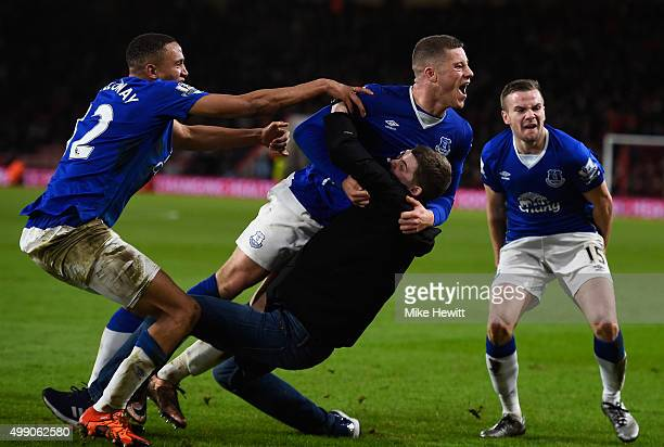 Ross Barkley of Everton is congratulated by a pitch invading Everton fan during the Barclays Premier League match between AFC Bournemouth and Everton...