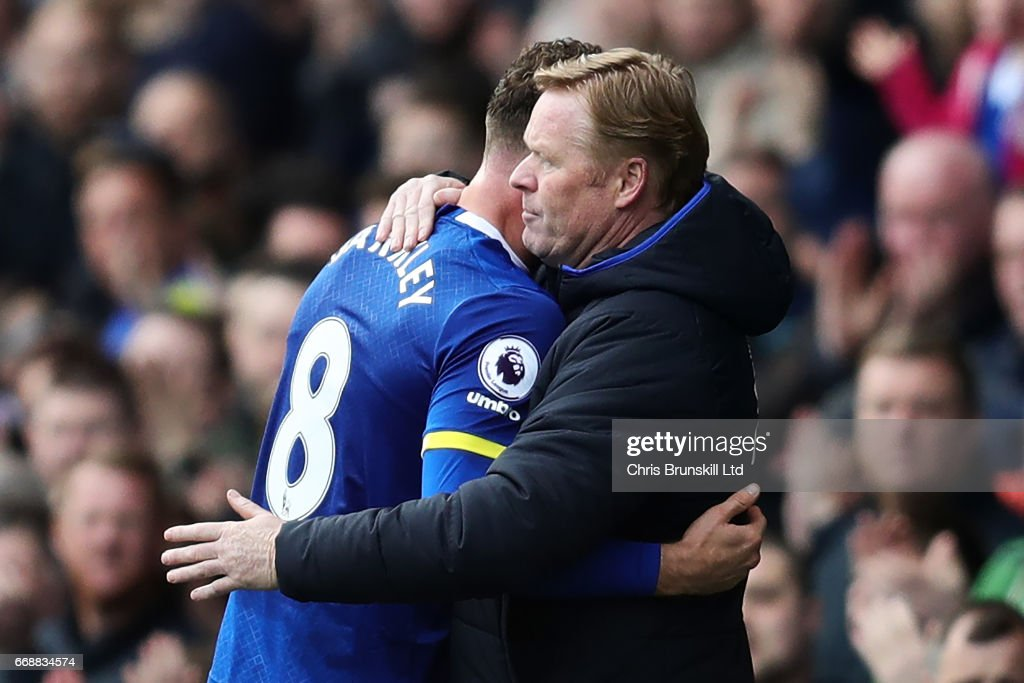 Ross Barkley of Everton is embraced by his Manager / Head Coach Ronald Koeman during the Premier League match between Everton and Burnley at Goodison Park on April 15, 2017 in Liverpool, England.