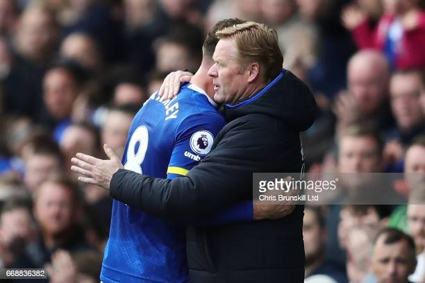 Ross Barkley of Everton is embraced by his Manager / Head Coach Ronald Koeman during the Premier League match between Everton and Burnley at Goodison...