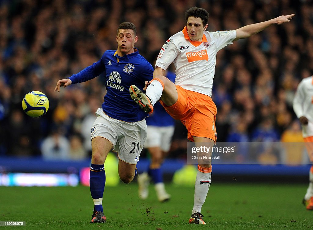 Ross Barkley of Everton is tackled by Craig Cathcart of Blackpool during the FA Cup Fifth Round match between Everton and Blackpool at Goodison Park on February 18, 2012 in Liverpool, England.