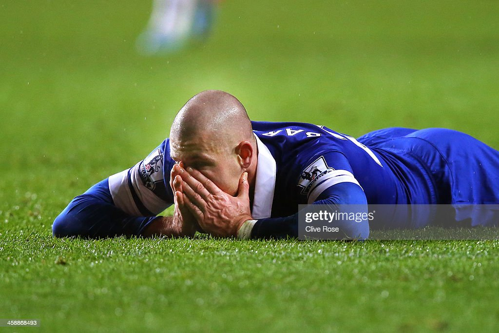 Ross Barkley of Everton reacts after a missed chance on goal during the Barclays Premier League match between Swansea City and Everton at the Liberty Stadium on December 22, 2013 in Swansea, Wales.