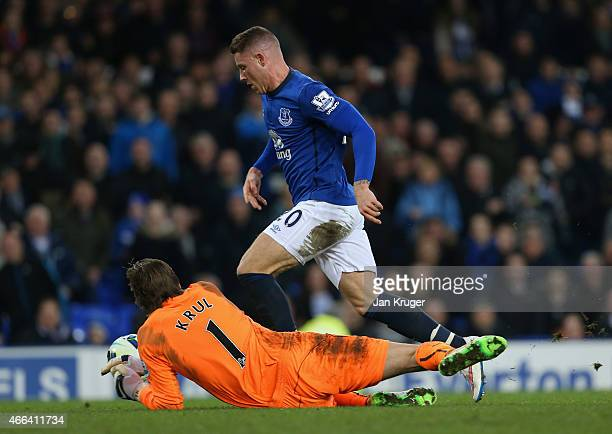 Ross Barkley of Everton rounds Tim Krul of Newcastle United to score the their third goal during the Barclays Premier League match between Everton...
