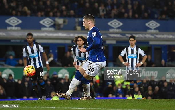 Ross Barkley of Everton scores his team's third goal from the penalty spot during the Barclays Premier League match between Everton and Newcastle...