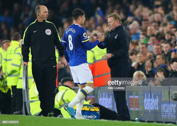 Ross Barkley of Everton shakes hands with Ronald Koeman Manager of Everton as he is subbed off during the Premier League match between Everton and...