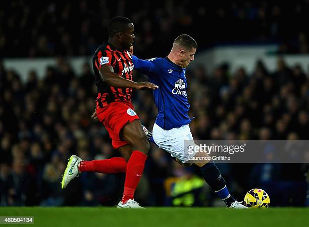 Ross Barkley of Everton shoots and scores the opening goal under pressure from Nedum Onuoha of QPR during the Barclays Premier League match between...