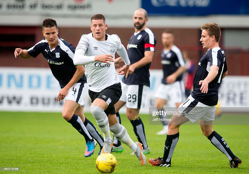 Ross Barkley of Everton surrounded by Dundee's (L-R) Thomas Konrad, Gary Harkins and Simon Ferry at the Pre Season Friendly match between Dundee and Everton at Dens Park on July 28, 2015 in Dundee, Scotland.