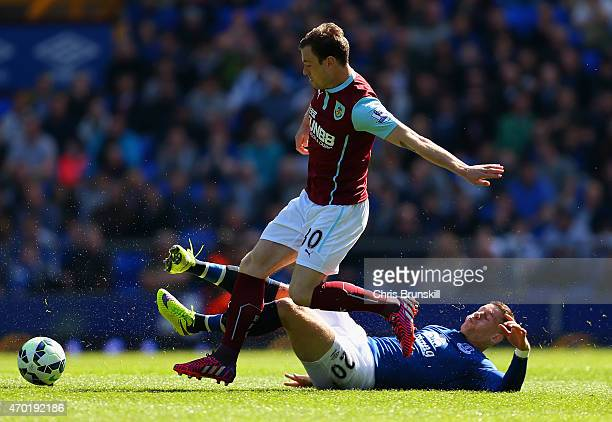 Ross Barkley of Everton tackles Ashley Barnes of Burnley during the Barclays Premier League match between Everton and Burnley at Goodison Park on...