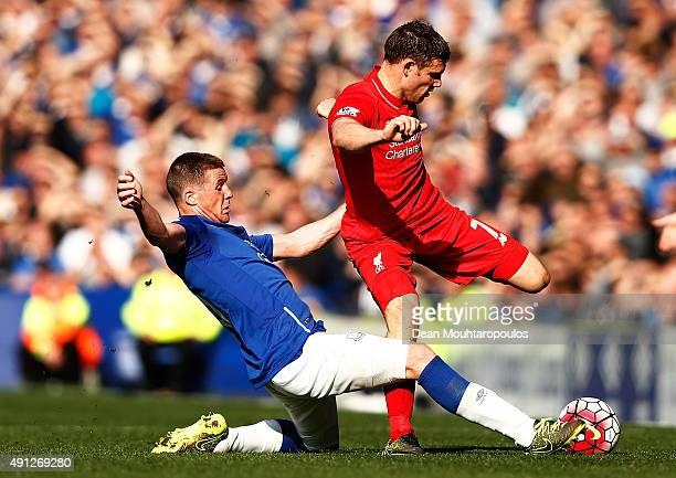 Ross Barkley of Everton tackles James Milner of Liverpool during the Barclays Premier League match between Everton and Liverpool at Goodison Park on...