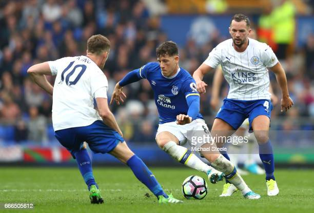 Ross Barkley of Everton takes on Andy King and Danny Drinkwater of Leicester City during the Premier League match between Everton and Leicester City...