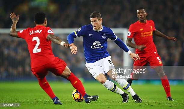 Ross Barkley of Everton takes on Nathaniel Clyne of Liverpool during the Premier League match between Everton and Liverpool at Goodison Park on...