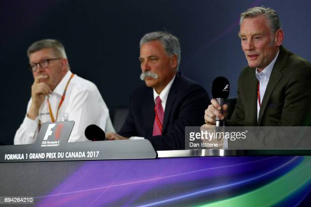 Ross Brawn Managing Director of the Formula One Group Chase Carey CEO and Executive Chairman of the Formula One Group and Sean Bratches Managing...