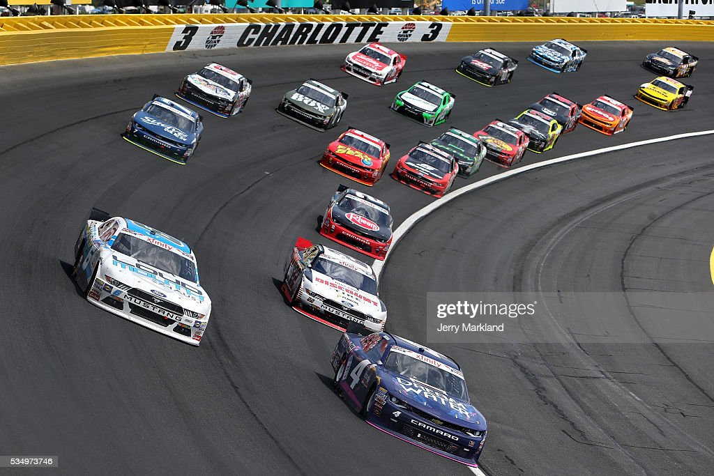 Ross Chastain, driver of the #4 Dream Water Chevrolet, and <a gi-track='captionPersonalityLinkClicked' href=/galleries/search?phrase=Darrell+Wallace+Jr.&family=editorial&specificpeople=7123625 ng-click='$event.stopPropagation()'>Darrell Wallace Jr.</a>, driver of the #6 LoudMouth Exhaust Ford, lead the field during the NASCAR XFINITY Series Hisense 300 at Charlotte Motor Speedway on May 28, 2016 in Charlotte, North Carolina.