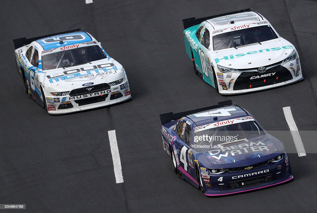 Ross Chastain, driver of the #4 Dream Water Chevrolet, leads <a gi-track='captionPersonalityLinkClicked' href=/galleries/search?phrase=Denny+Hamlin&family=editorial&specificpeople=504674 ng-click='$event.stopPropagation()'>Denny Hamlin</a>, driver of the #18 Hisense USA Toyota, and <a gi-track='captionPersonalityLinkClicked' href=/galleries/search?phrase=Darrell+Wallace+Jr.&family=editorial&specificpeople=7123625 ng-click='$event.stopPropagation()'>Darrell Wallace Jr.</a>, driver of the #6 LoudMouth Exhaust Ford, during the NASCAR XFINITY Series Hisense 300 at Charlotte Motor Speedway on May 28, 2016 in Charlotte, North Carolina.