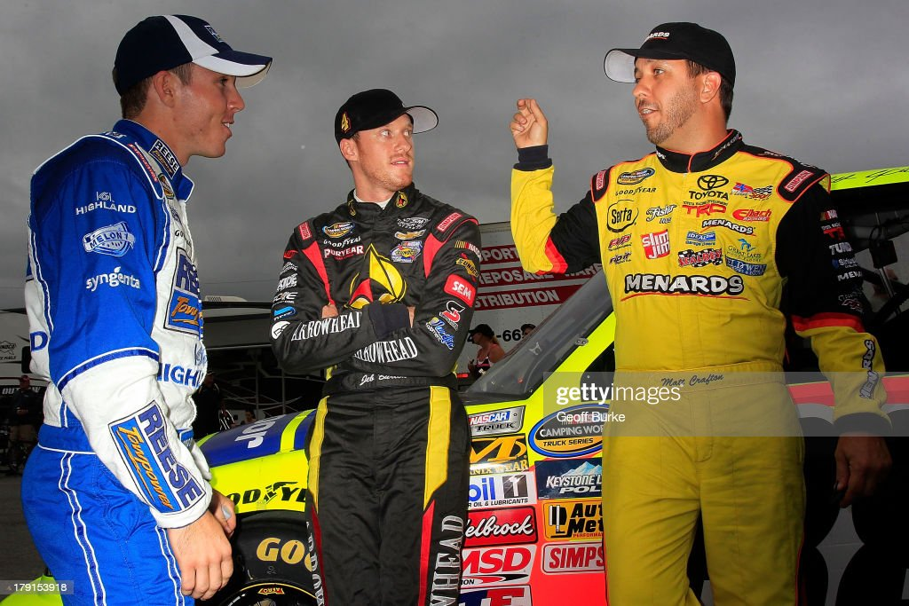 Ross Chastain, driver of the #19 Reese Towpower/Parts Source Ford, and <a gi-track='captionPersonalityLinkClicked' href=/galleries/search?phrase=Jeb+Burton&family=editorial&specificpeople=8936842 ng-click='$event.stopPropagation()'>Jeb Burton</a>, driver of the #4 Arrowhead Chevrolet, listen to <a gi-track='captionPersonalityLinkClicked' href=/galleries/search?phrase=Matt+Crafton&family=editorial&specificpeople=561821 ng-click='$event.stopPropagation()'>Matt Crafton</a>, driver of the #Ideal Door/Menards Toyota, during qualifying for the NASCAR Camping World Truck Series Chevrolet Silverado 250 at Canadian Tire Motorsport Park on August 31, 2013 in Bowmanville, Canada.