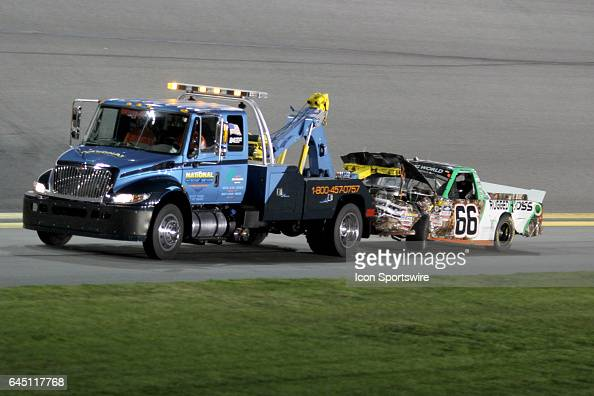 Ross Chastain's truck is towed back to the garage after a 1st lap wreck during NASCAR Camping World Truck Series NextEra Energy Resources 250 on...