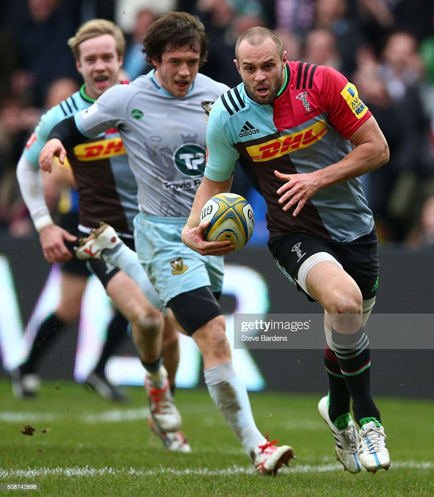 Ross Chisholm of Harlequins breaks away to score a try during the Aviva Premiership match between Harlequins and Northampton Saints at Twickenham Stoop on February 6, 2016 in London, England.