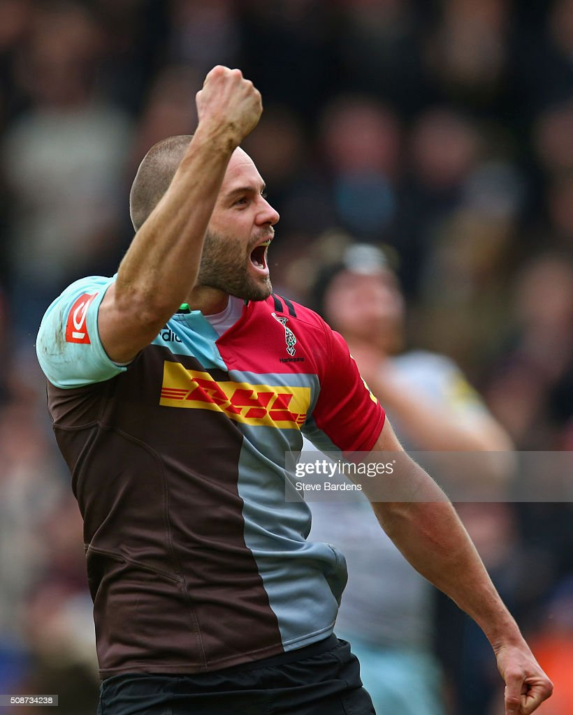 Ross Chisholm of Harlequins celebrates scoring a try during the Aviva Premiership match between Harlequins and Northampton Saints at Twickenham Stoop on February 6, 2016 in London, England.