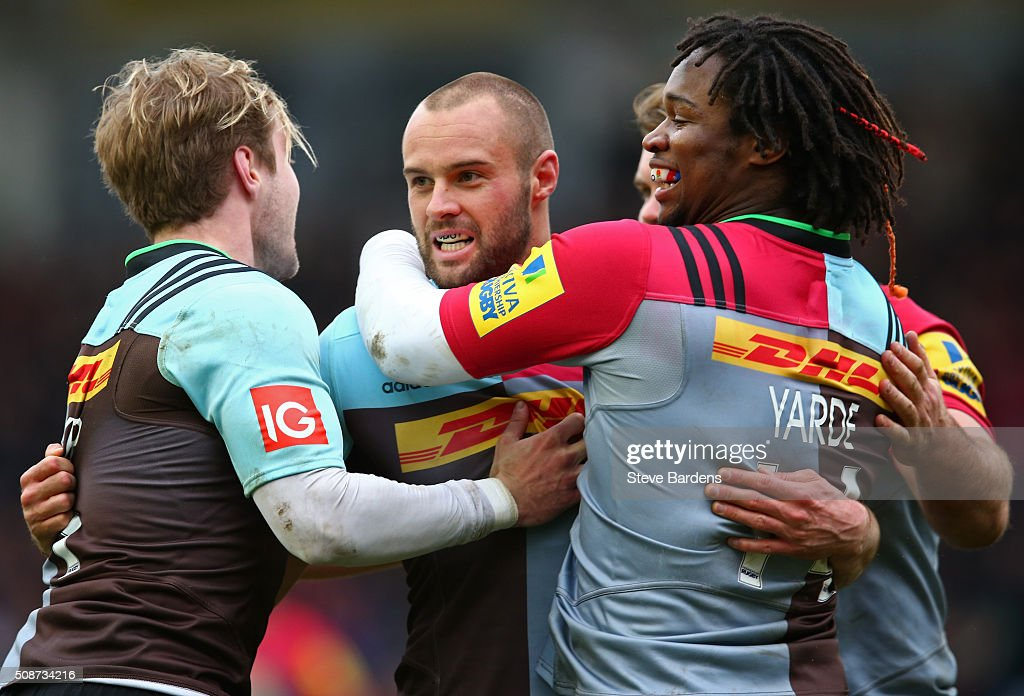 Ross Chisholm of Harlequins celebrates scoring a try with his team mates during the Aviva Premiership match between Harlequins and Northampton Saints at Twickenham Stoop on February 6, 2016 in London, England.