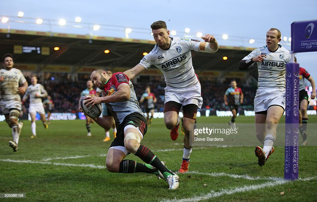 Ross Chisholm of Harlequins evades the tackle from Alex Cuthbert of Cardiff Blues to score his team's fourth try during the European Rugby Challenge...