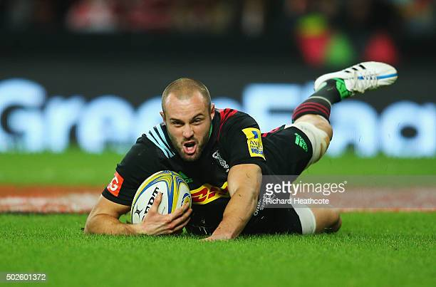 Ross Chisholm of Harlequins scores his teams fourth try during the Aviva Premiership 'Big Game 8' match between Harlequins and Gloucester at...