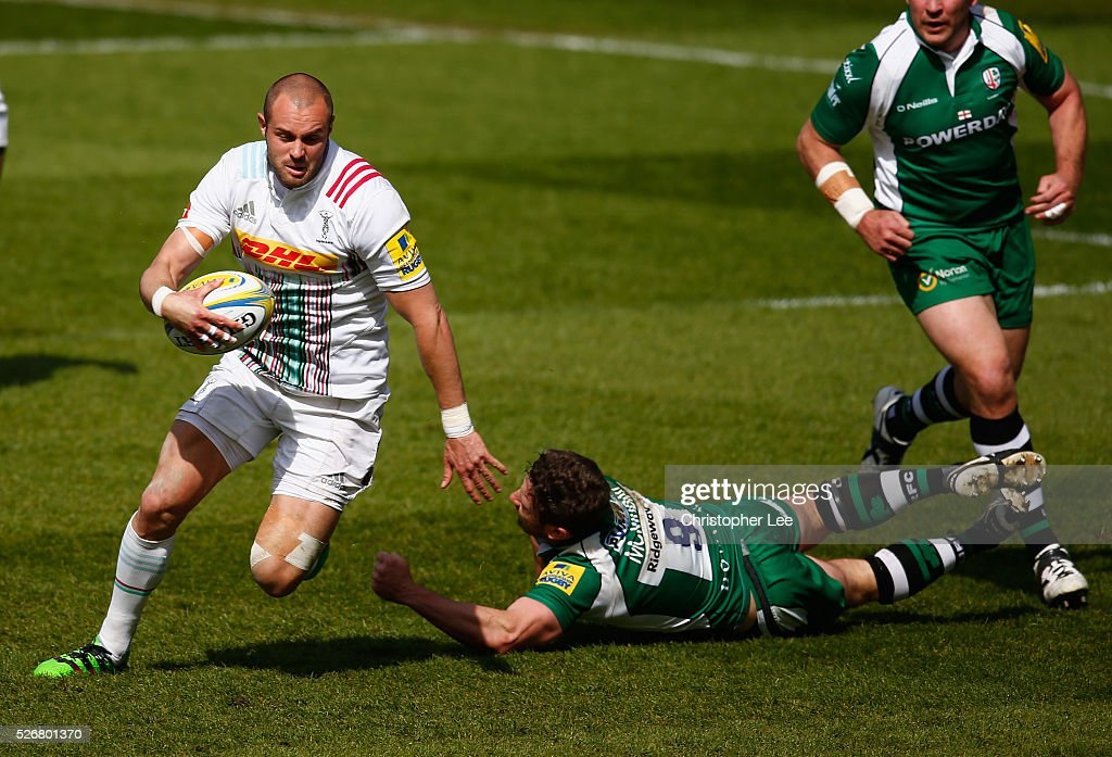 Ross Chisholm of Quins gets away from Brendan McKibbin of Irish during the Aviva Premiership match between London Irish and Harlequins at the Madejski Stadium on 1 May, 2016 in Reading, England.